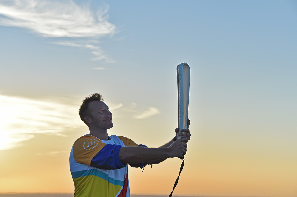 Ian Thorpe with the Queen's Baton
