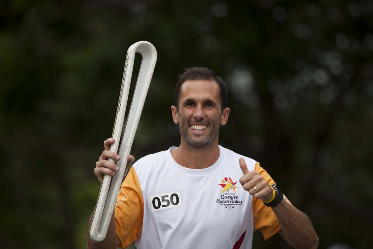 Mark Knowles carries the Queen's Baton in Rockhampton