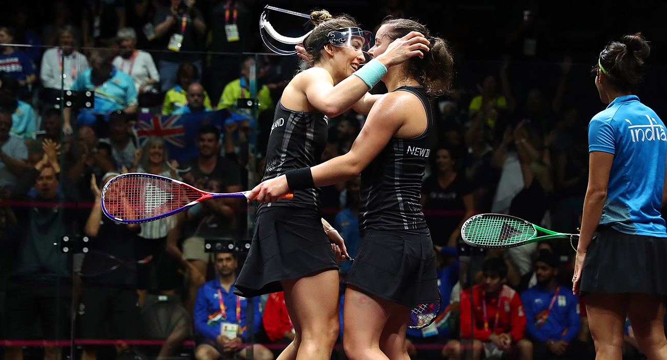 Amanda Landers-Murphy and Joelle King of New Zealand celebrate winning against Dipika Pallikal Karthik and Joshna Chinappa of India during the Women's Doubles Gold Medal