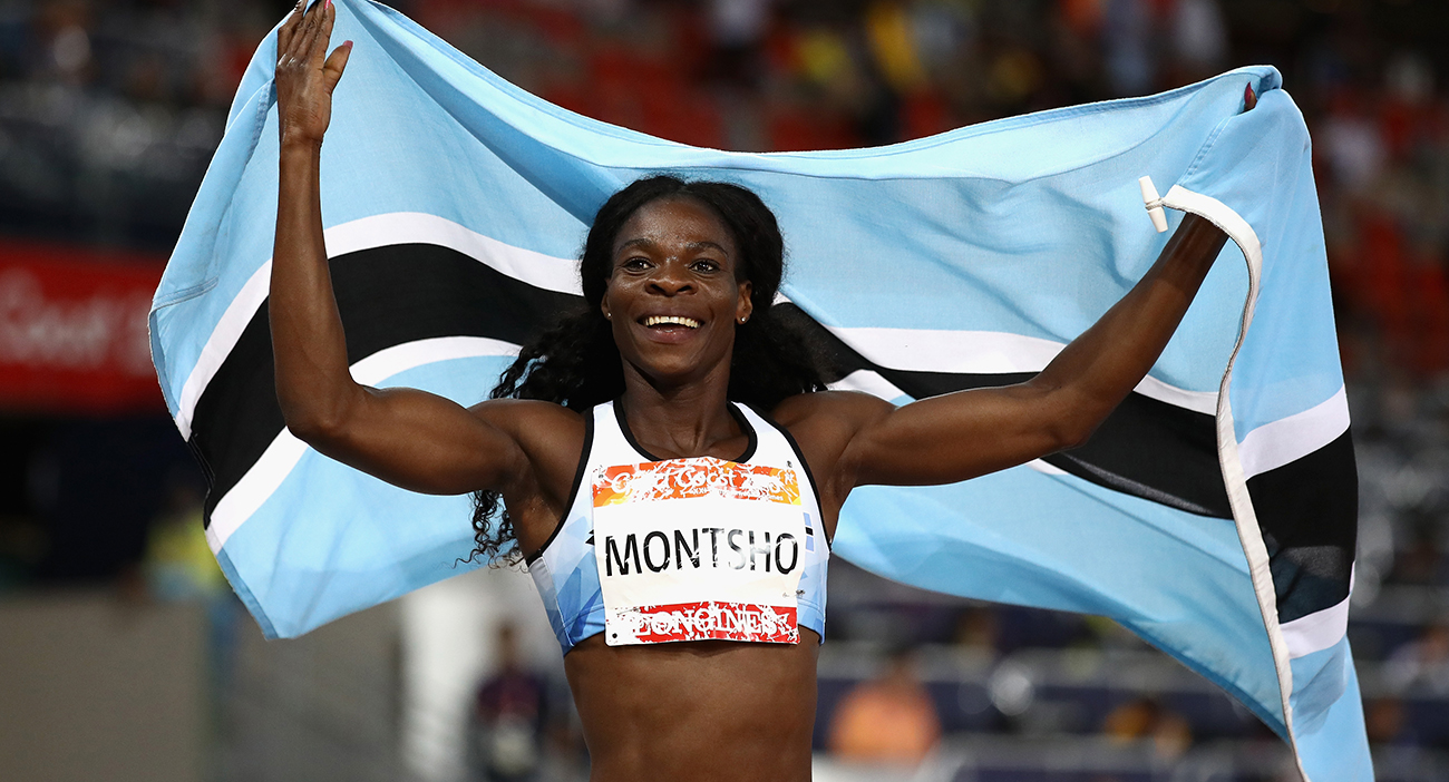 Amantle Montsho of Botswana celebrates as she wins gold in the Women's 400 metres final