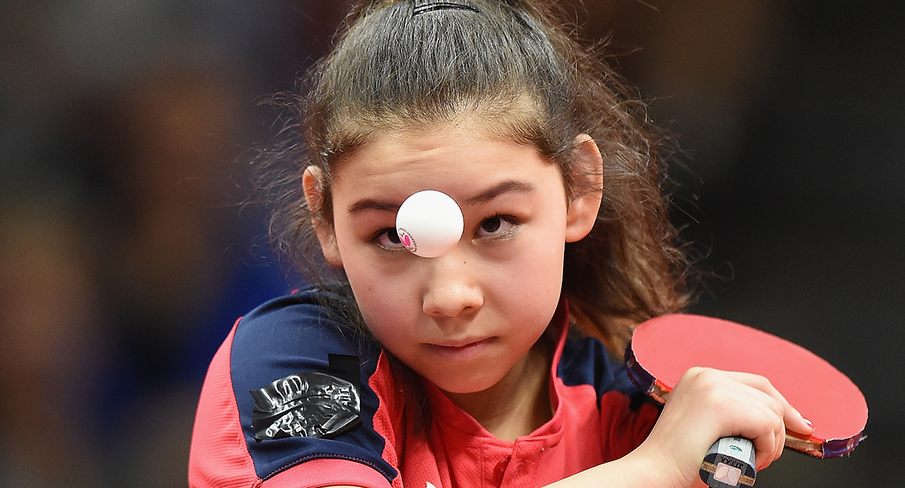 Anna Hursey gets ready to serve the table tennis ball.
