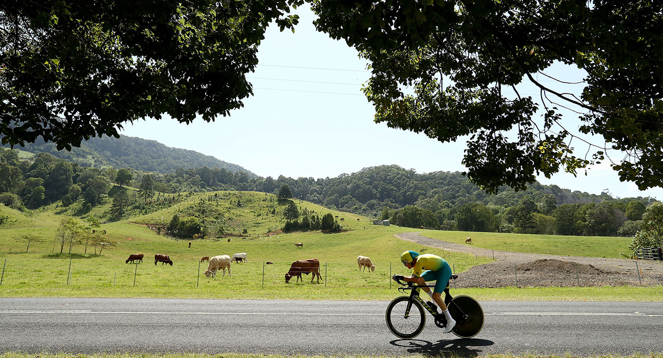 Australia's Cameron Meyer cycling past a field full of cows during the Cycling Time Trial at Currumbin.