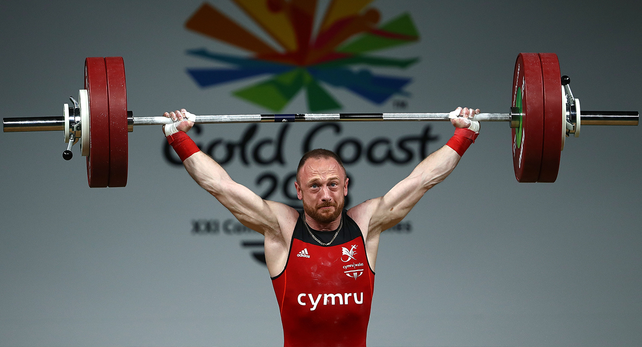 Gareth Evans wins gold for Wales lifting more than anyone in the weightlifting.