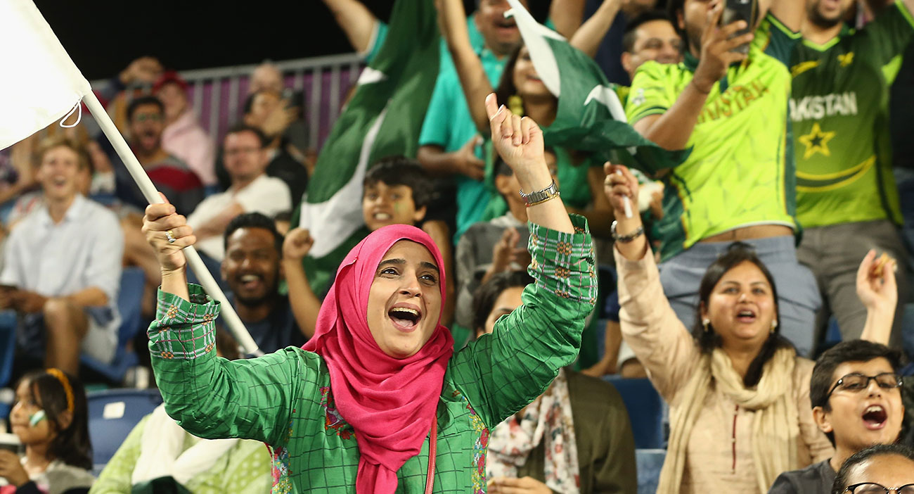 Fans cheer on Pakistan at the Hockey