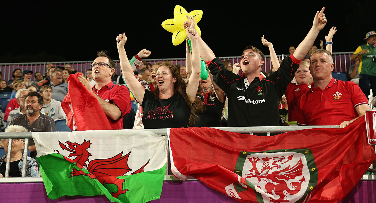 Fans cheer on Wales at the Hockey