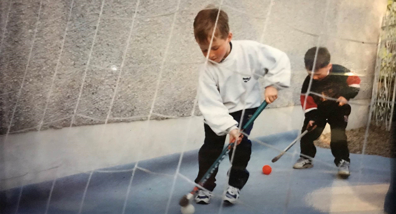 David and Alan Forsyth practice hockey in their backyard.
