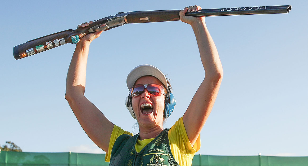 Laetisha Scanlan celebrates after making her final shot and winning the women's trap finals