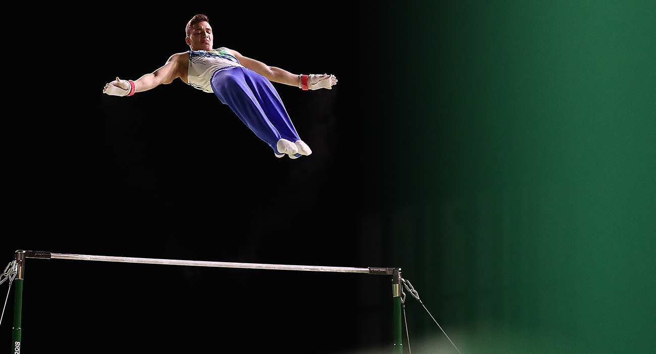 Ilias Georgiou of Cyprus competes on the high bar during the Gymnastics Artistic Men's Team event.