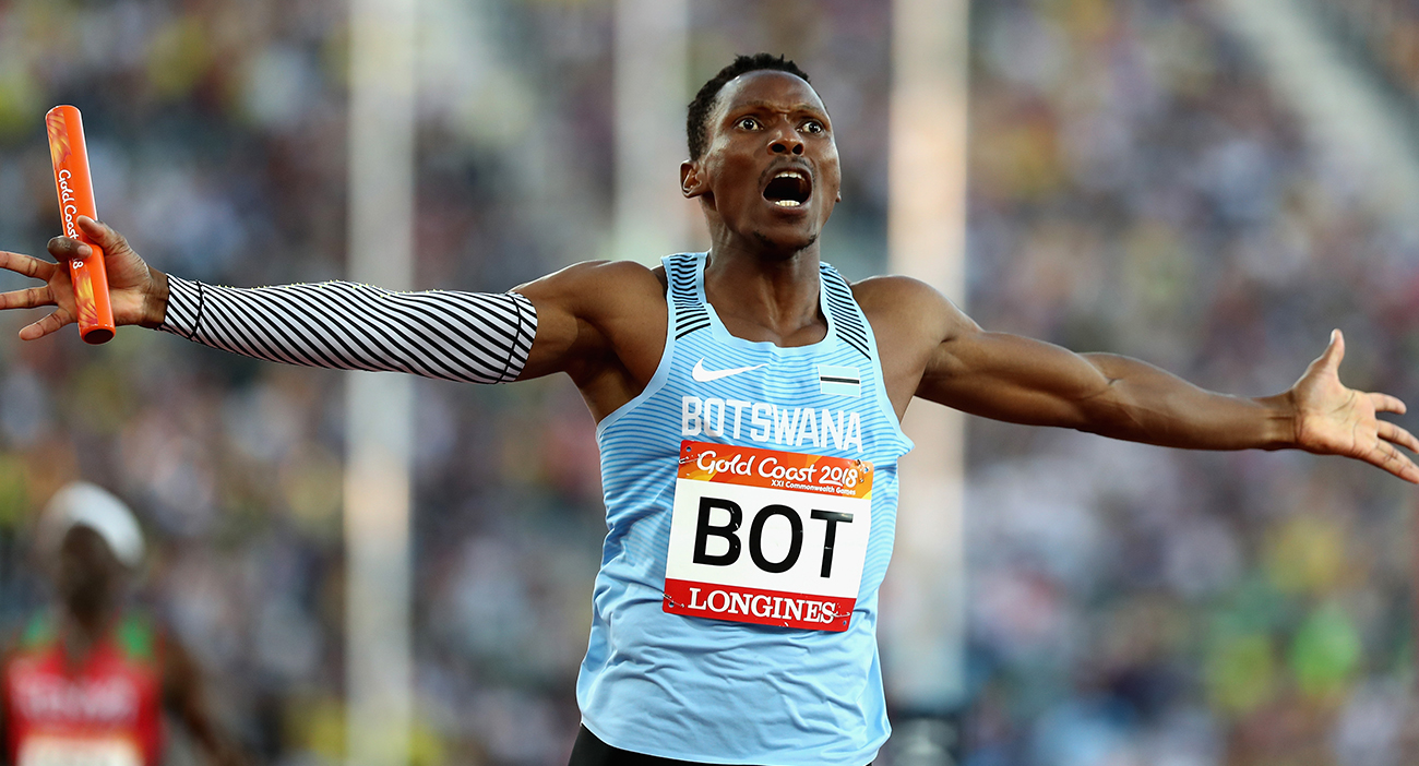 Isaac Makwala of Botswana celebrates as he crosses the line to win gold in the Men's 4x400 metres relay final