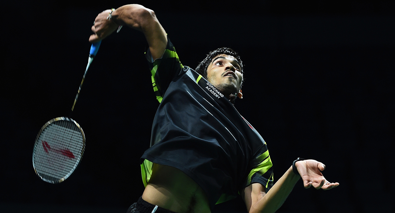 Indian Badminton player Srikanth Kidambi smashes the shuttlecock during a match.