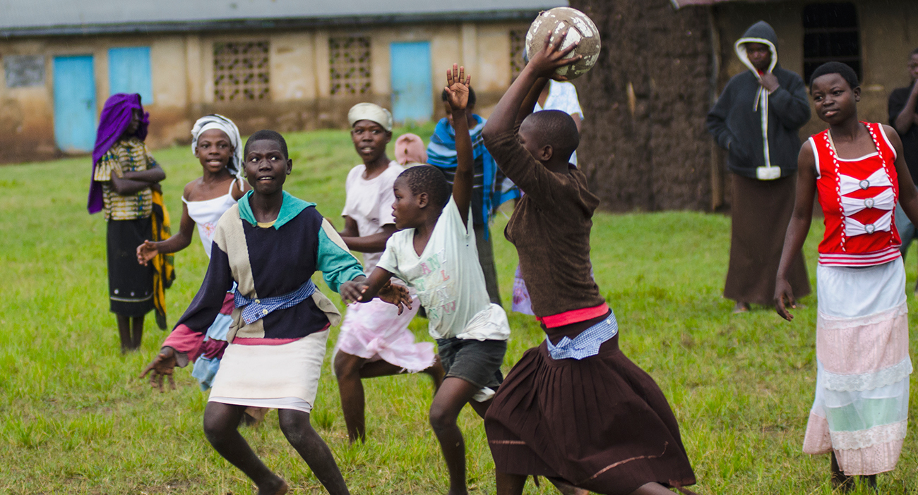 Adolescent Ugandan girls play netball in the village of Bumweru, Uganda.
