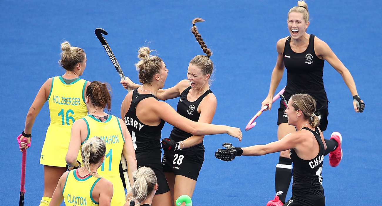 New Zealand's women's hockey team celebrate their win in the gold medal match against Australia.