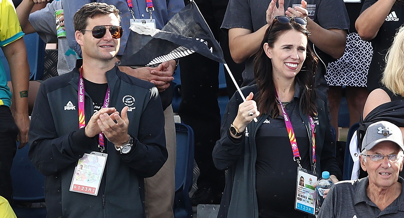 Prime Minister of New Zealand Jacinda Ardern and her partner Clarke Gayford, look on during the Women's Gold Medal match between Australia and New Zealand