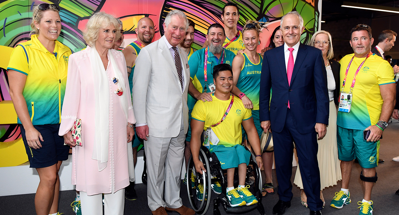 Prince Charles and Camilla spend time in the Athletes Village.