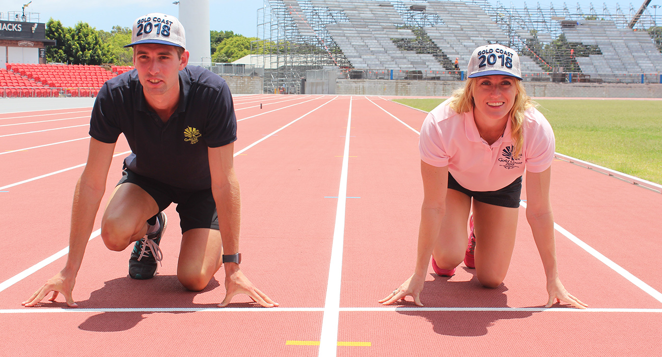 Cedric Dubler and Sally Pearson check out the newly laid GC2018 athletics track at Carrara Stadium.