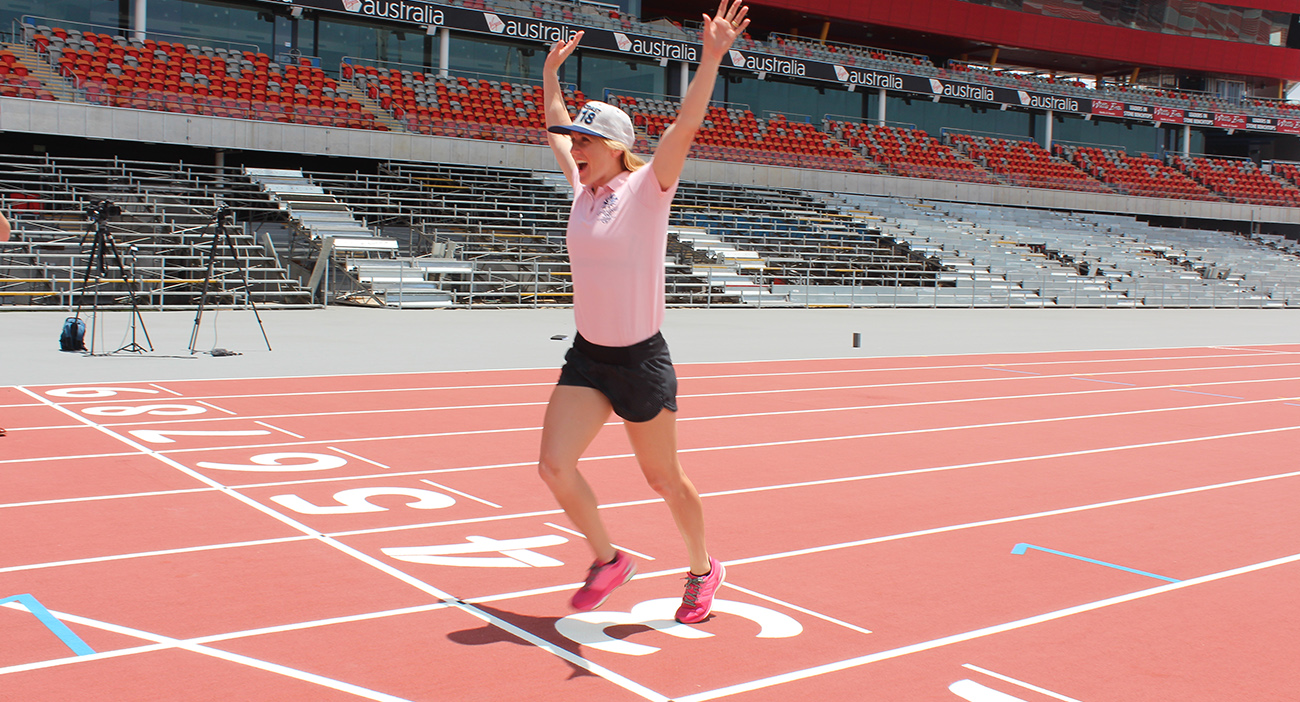Sally Pearson practices her dip at the finish line of the newly laid GC2018 athletics track at Carrara Stadium on the Gold Coast.