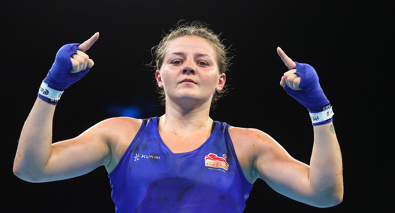 Sandy Ryan of England celebrates winning against Rosie Eccles of Wales in the Women's 69kg Final Bout