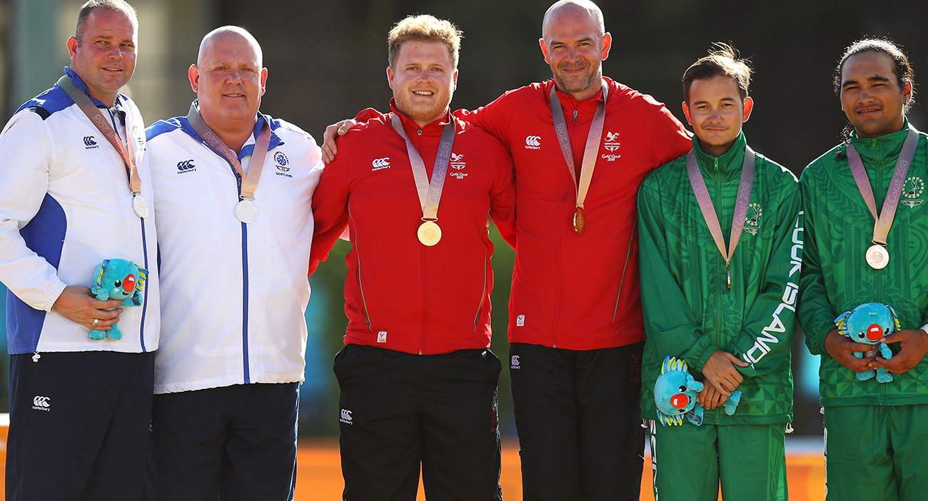 Silver medalists Paul Foster and Alexander Marshall of Scotland, gold medalists Daniel Salmon and Marc Wyatt of Wales and bronze medalists Aidan Zittersteijn and Taiki Paniani of the Cook Islands