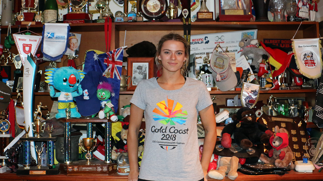 Skye Nicolson in front of all her family's boxing trophies and awards.