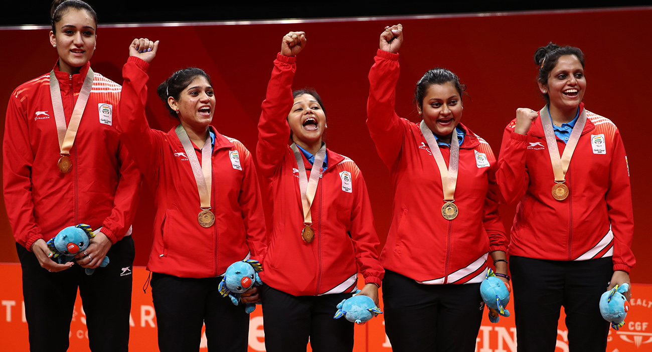 Sutirtha Mukherjee, Pooja Sahasrabudhe, Manika Batra, Madhurika Patkar and Mouma Das of India celebrate with their gold medals following their Womens Team gold medal match