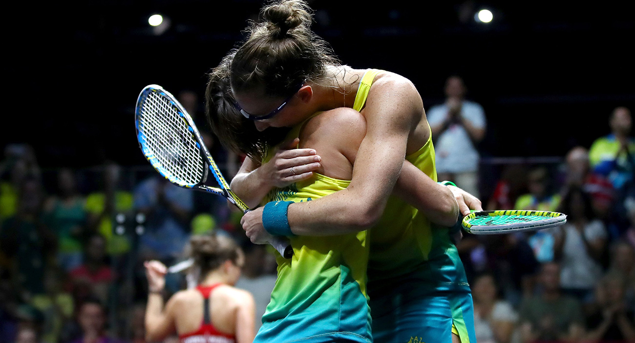 Rachael Grinham and Donna Urquhart of Australia celebrate victory during the Women's Doubles Quarterfinal Squash