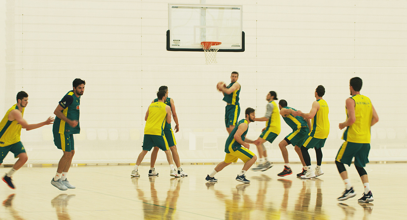 Australian men's basketball team practising on a basketball court