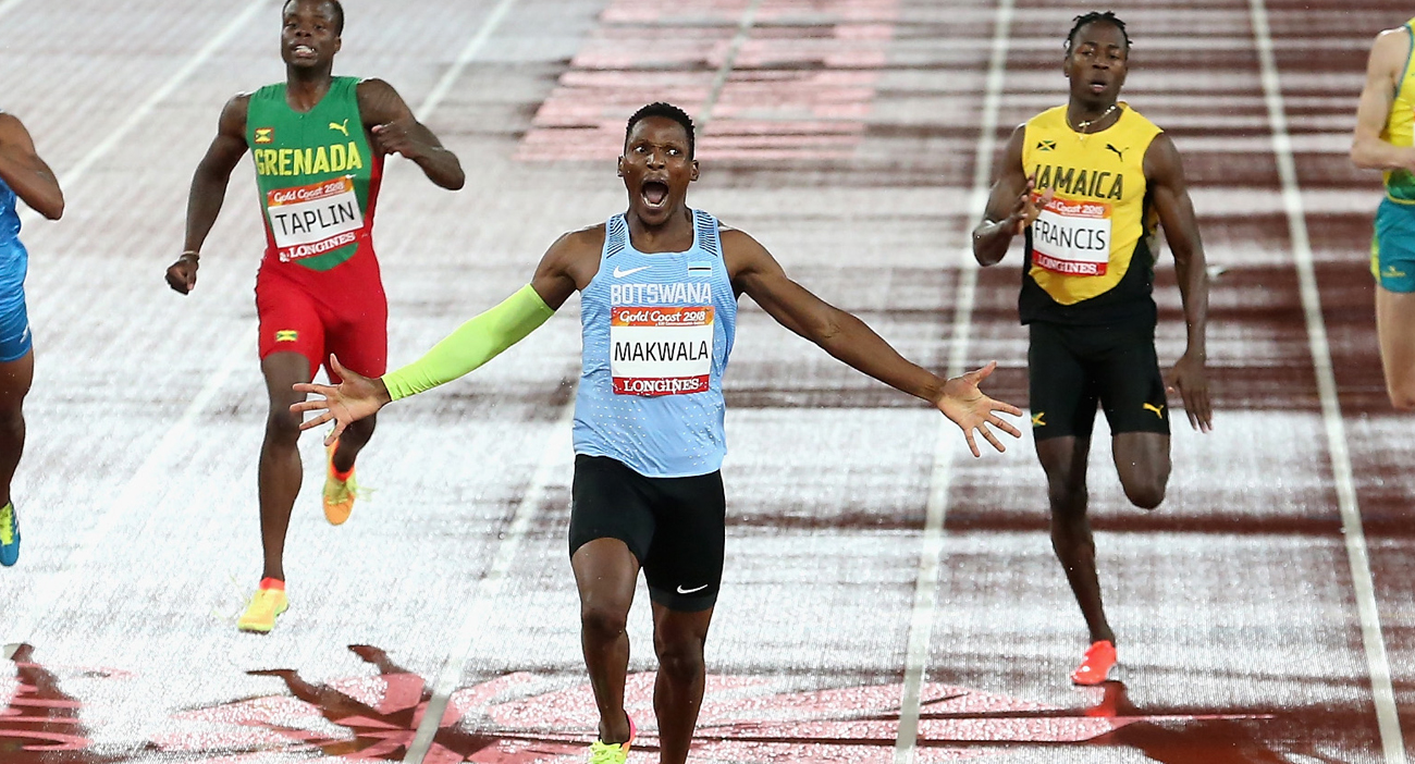 Isaac Makwala reacts when crossing the finish line