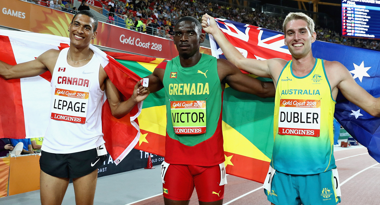 Silver medalist Pierce Lepage of Canada, gold medalist Lindon Victor of Grenada and bronze medalist Cedric Dubler of Australia celebrate after the Men's Decathlon 1500 metres