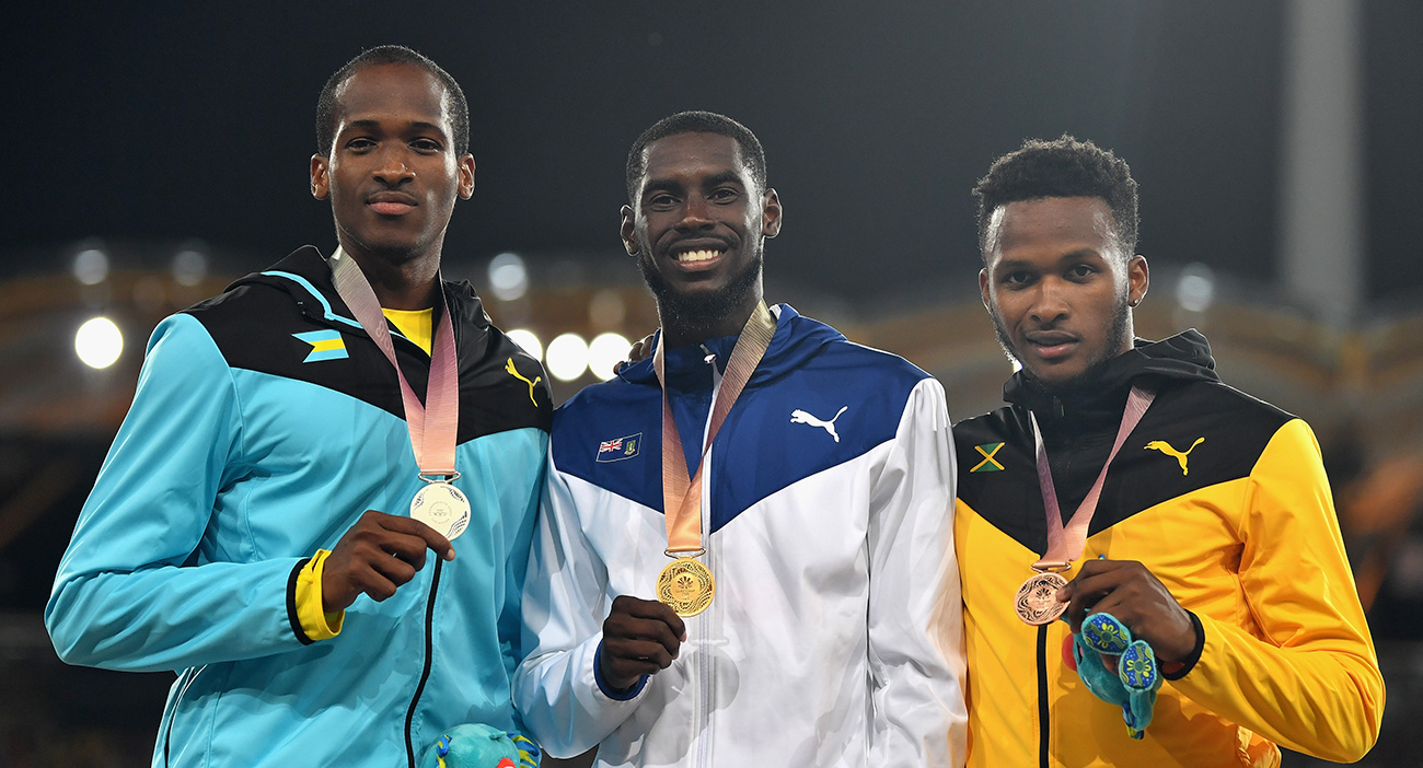 Silver medallist Jeffery Gibson of the Bahamas, gold medallist Kyron McMaster of Virgin Islands, British and bronze medallist Jaheel Hyde of Jamaica pose during the medal ceremony