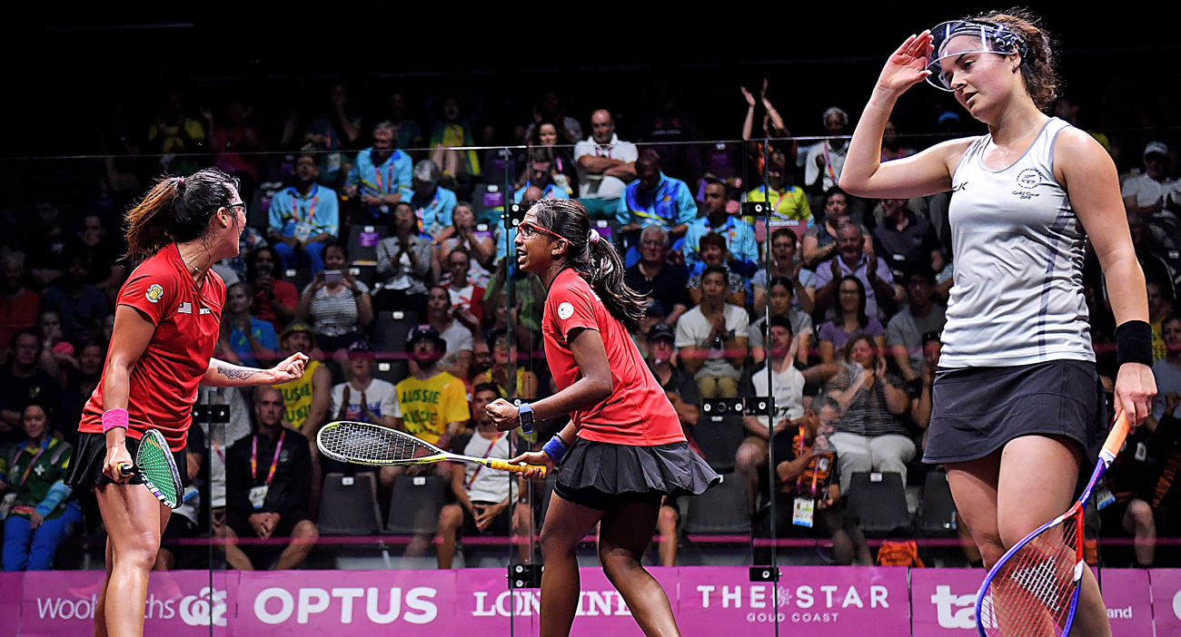 Rachel Arnold and Sivasangari Subramaniam of Malaysia celebrate after winning their Women's Doubles Group A match against New Zealand