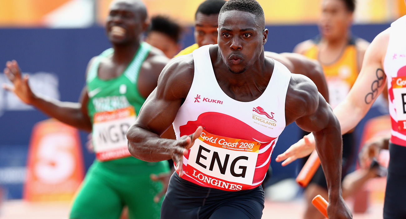 Harry Aikines-Aryeetey of England takes the baton on the last leg in the Men's 4x100 metres relay heats