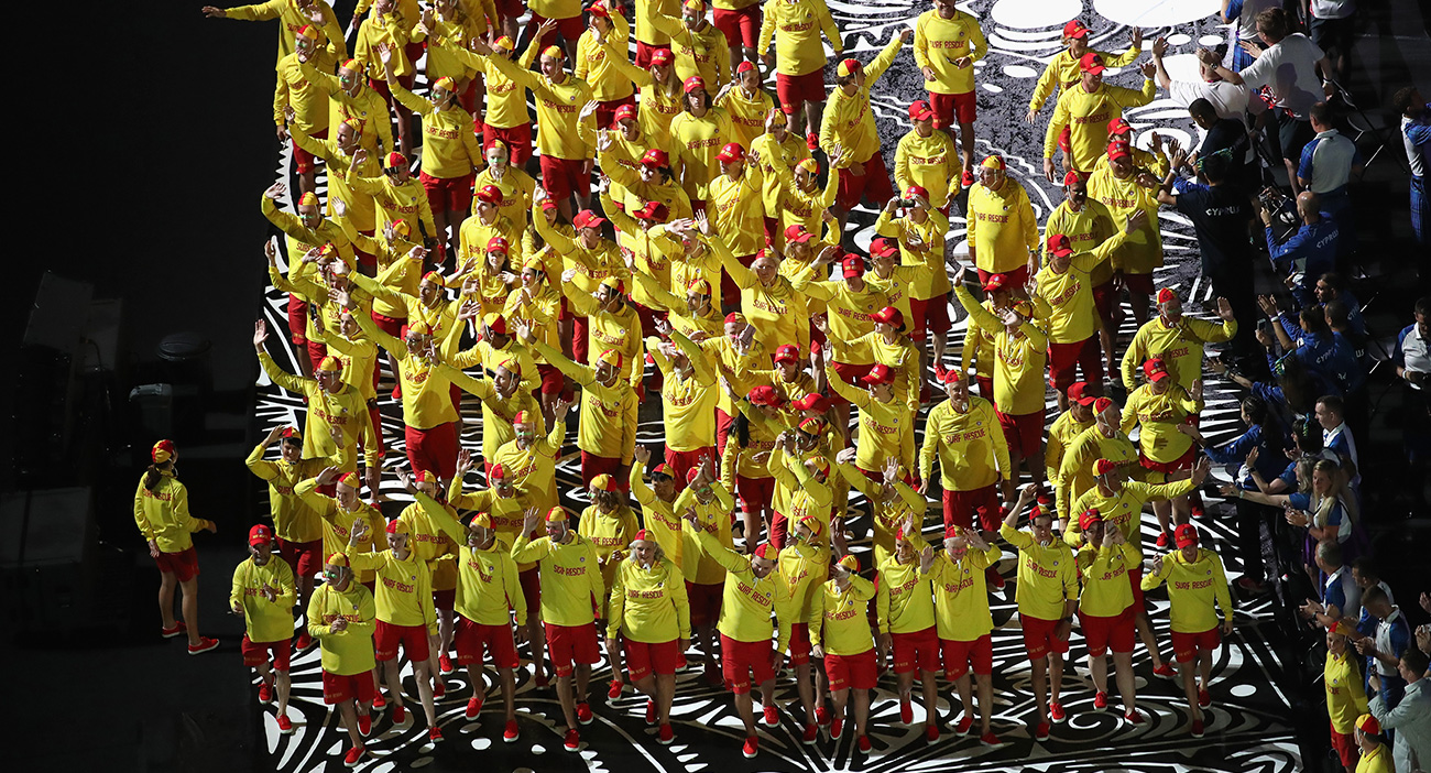 Surf life savers on the parade of nations track