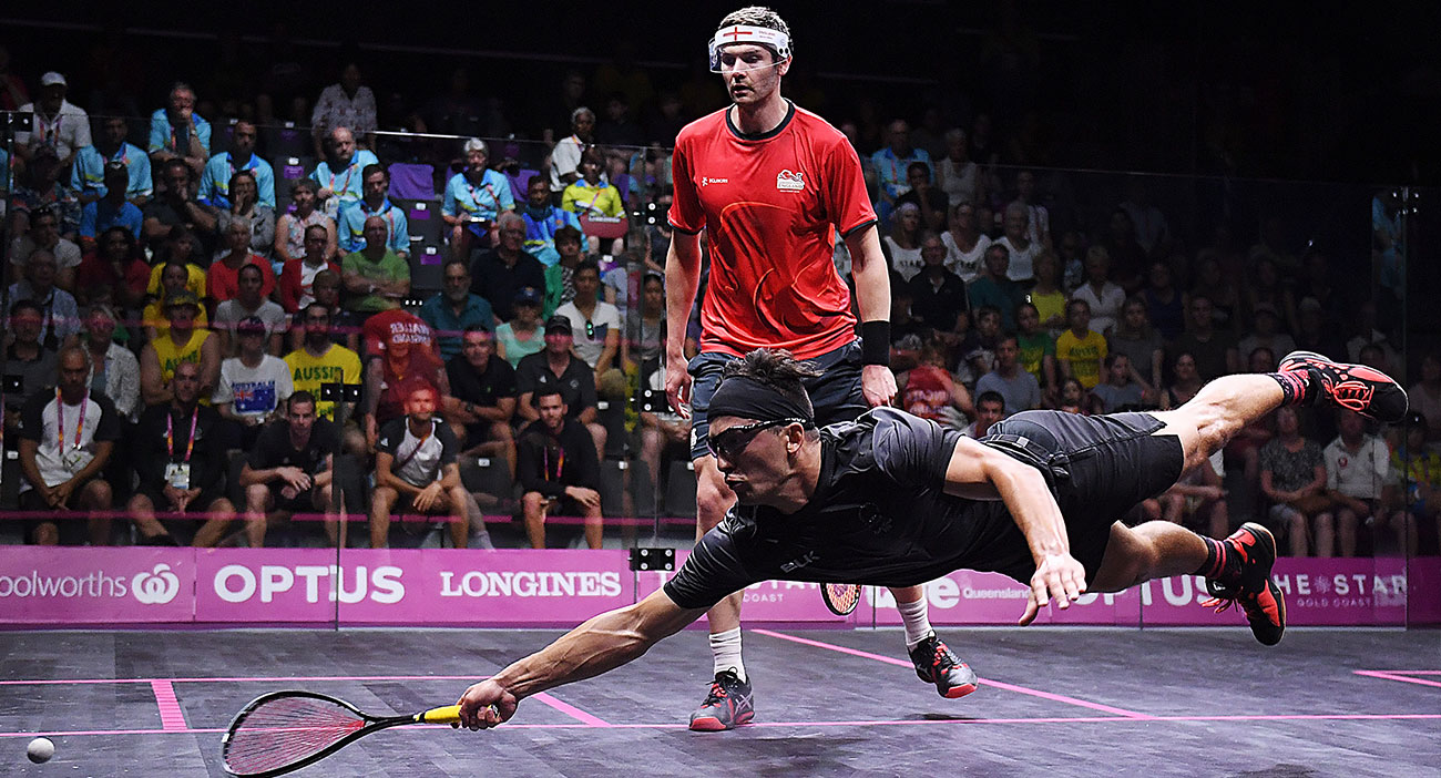Zac Millar of New Zealand competes in the Squash mixed doubles match against England.