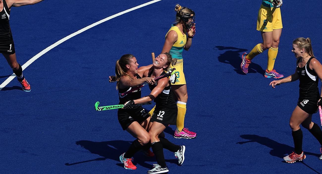 Anita Mclaren of New Zealand celebrates with teammates after scoring a first half goal against Australia during the quarter final hockey game on Day 10 of the Rio 2016 Olympic Games.