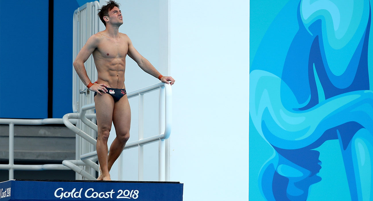 Tom Daley standing on a diving platform