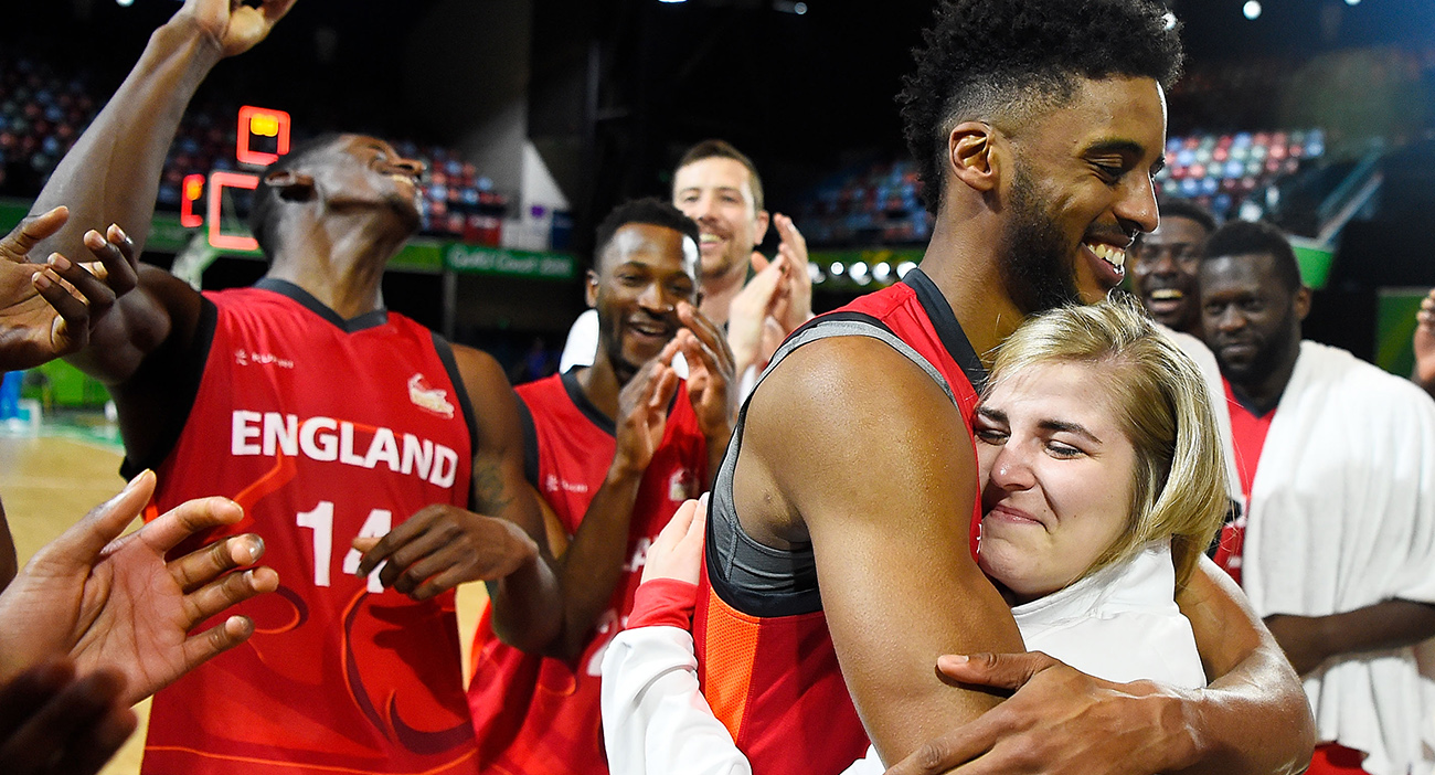 England's basketball players celebrate their engagement.