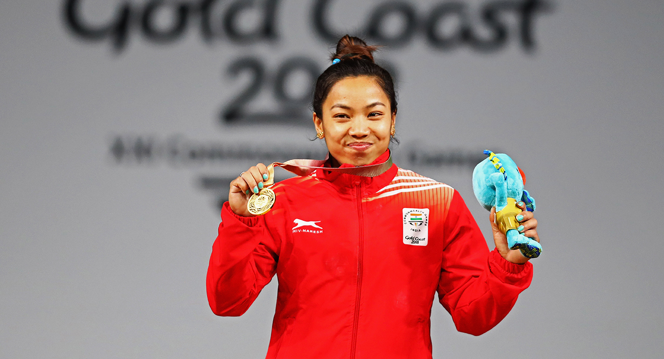 India's Saikhom Mirabau Chanu celebrates with her gold medal.