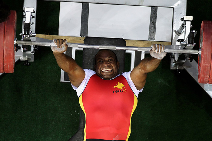 Para Powerlifting athlete performing a benchpress