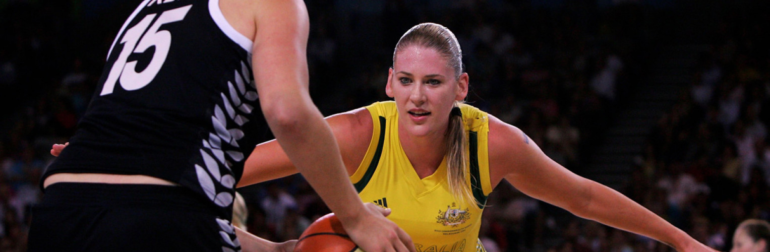 Lauren Jackson of Australia keeps a close eye on Aneka Kerr of New Zealand during the gold medal basketball match at the Melbourne 2006 Commonwealth Games