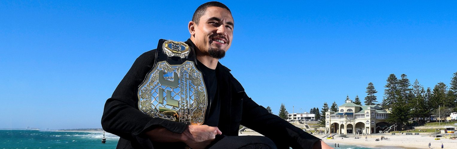 Australia UFC champion Rob Whittaker poses with his title.