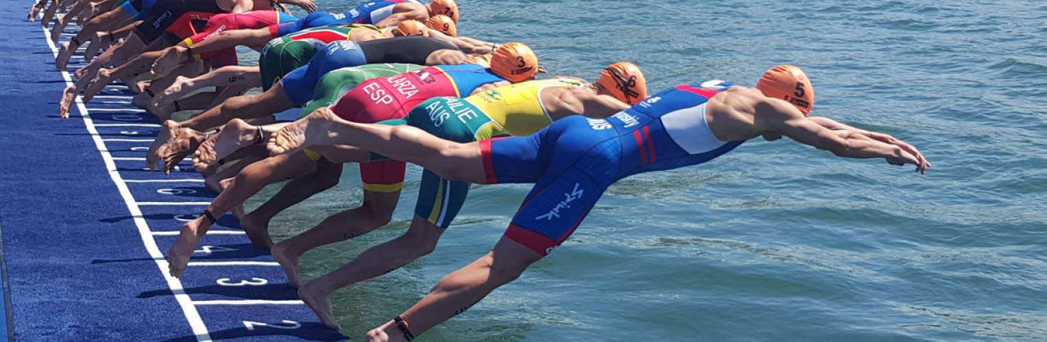 Triathletes dive into the water at the ITU World Triathlon Grand Final Gold Coast.