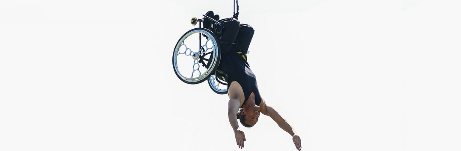 Rodney Bell performs in a spectacular aerial display in his wheelchair with Brydie Colquohoun at the launch of Festival 2018.