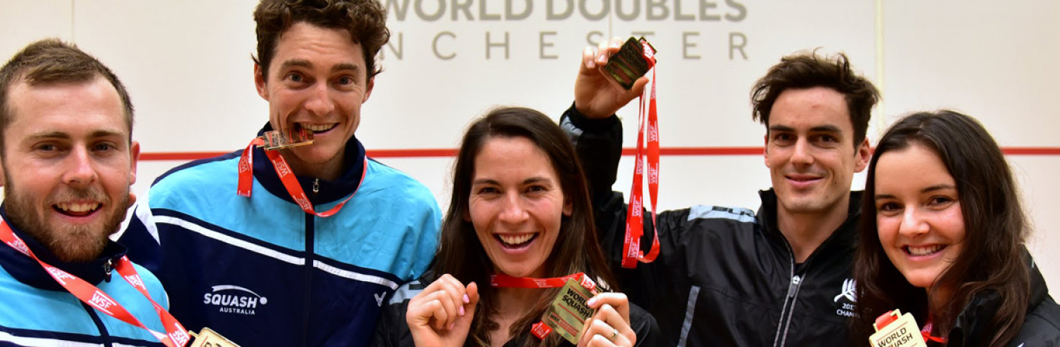 Winners of the men's and women's doubles and mixed, pose for the camera.