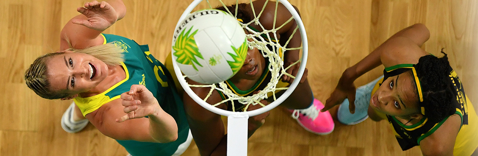 Caitlin Bassett of Australia scores a goal during the Netball Pool A match between Australia and Jamaica.