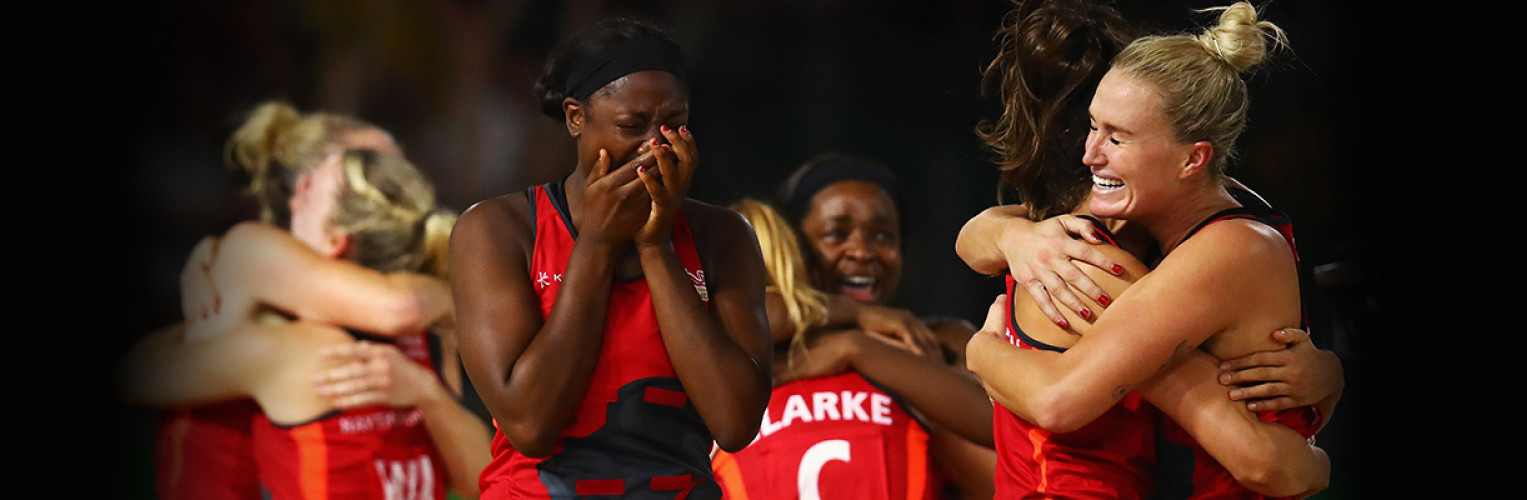 England's netball team celebrate their semifinal win.