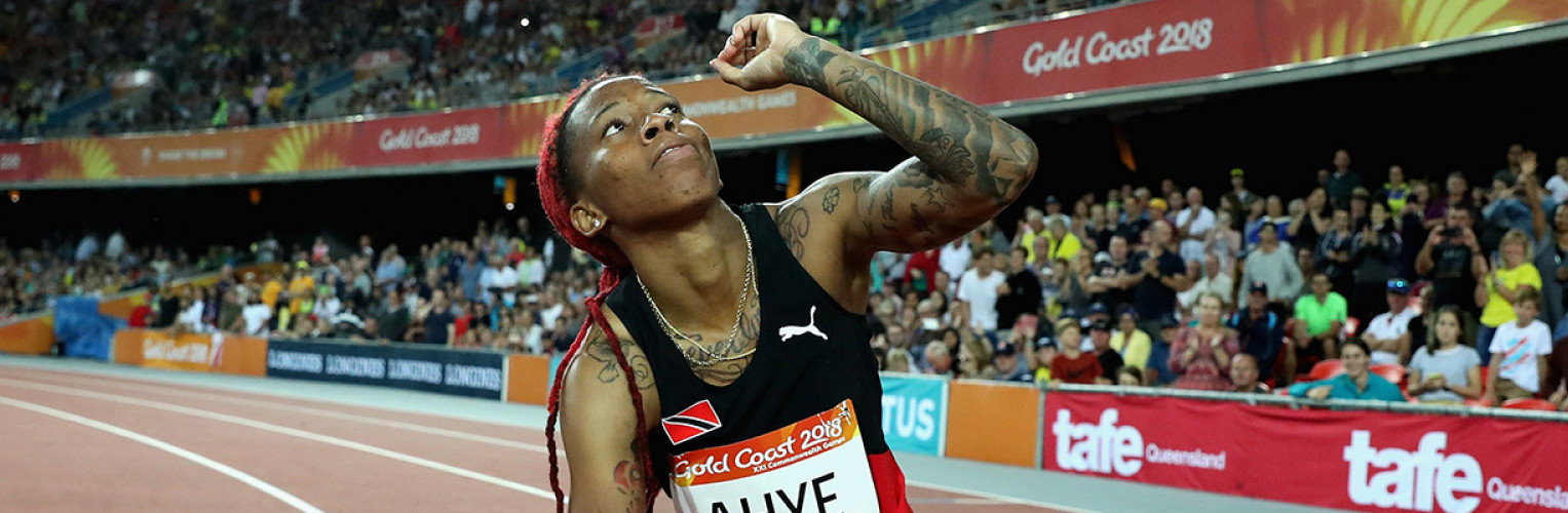 Michelle-Lee Ahye of Trinidad and Tobago celebrates her win in the women's 100m