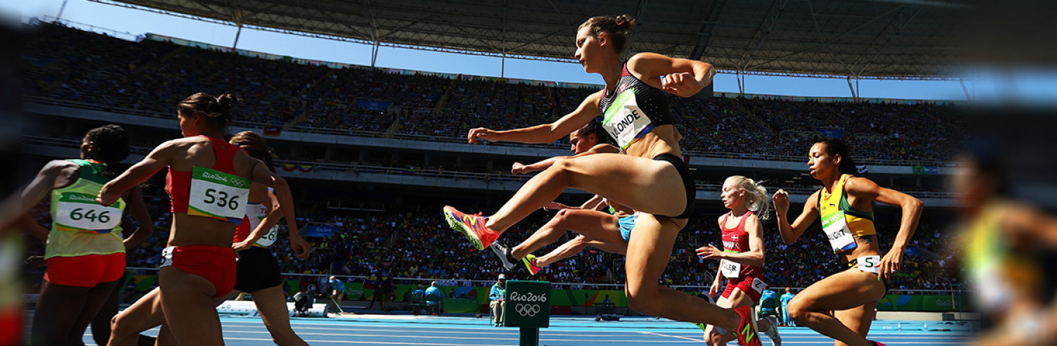 Genevieve Lalonde leaps over a steeple at the Rio 2016 Olympics