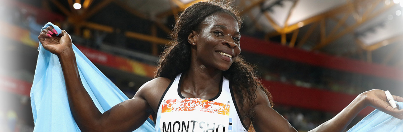 Amantle Montsho celebrates with the Botswana flag after winning the women's 400m.