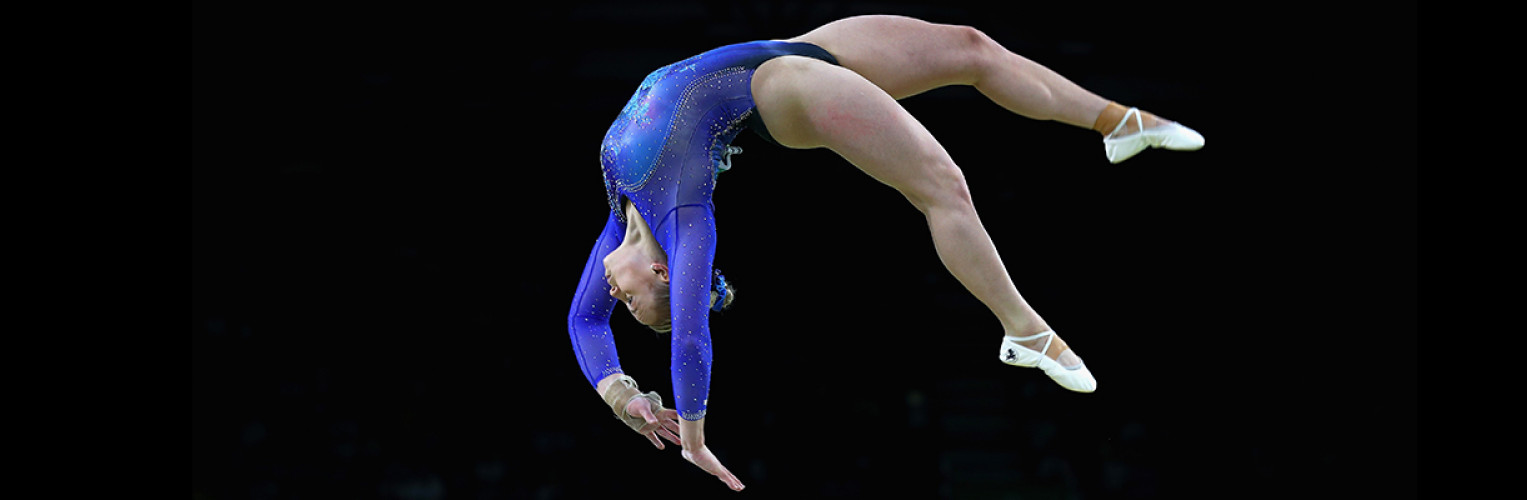 Elsabeth Black performs a backflip on the beam.