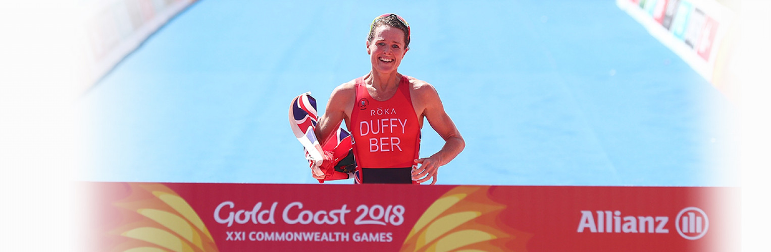 Flora Duffy of Bermuda celebrates on her way to winning gold on day one of the Gold Coast 2018 Commonwealth Games at Southport Broadwater Parklands on April 5, 2018.